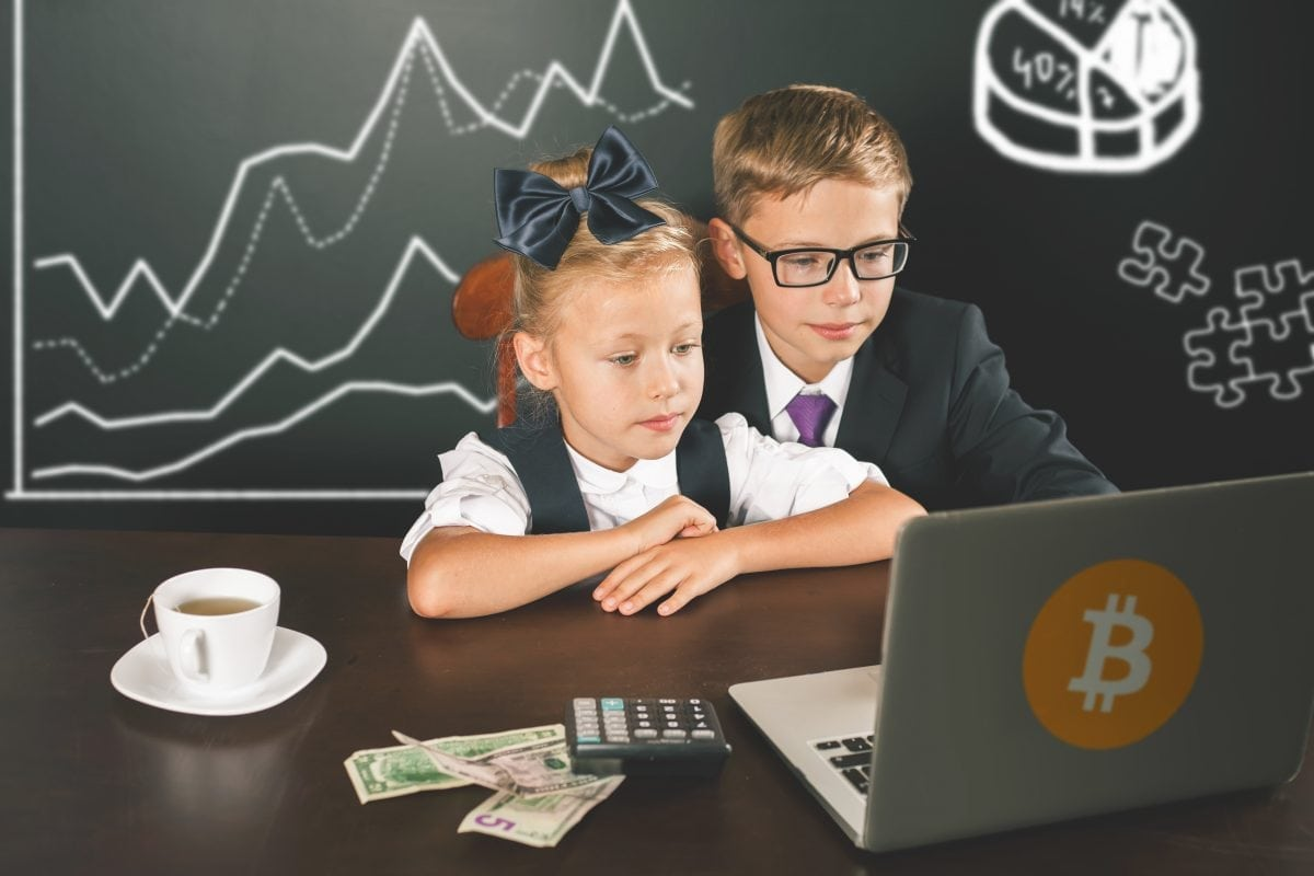Two children at a laptop reseraching Bitcoin